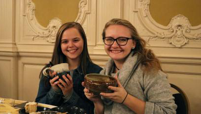 Students Abbigail Woodring and Ashlie Vesper at the 23rd annual Empty Bowl Benefit Dinner.