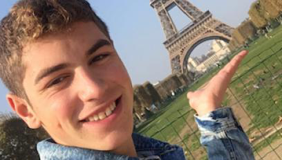 Nick Schiavo posing next to Eiffel Tower in Paris
